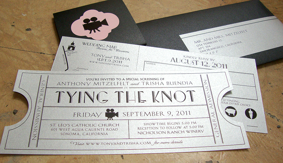 Their enclosure card is tucked behind the ticket invite held together by a